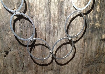 necklace in matted silver oval rings